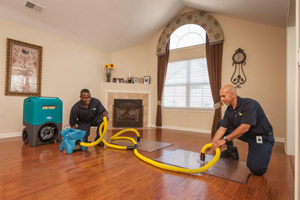 ServiceMaster by CME techs restoring water damage in a Pasa Robles home